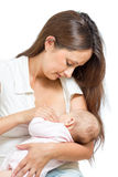 Sweet mother breast feeding her infant isolated Royalty Free Stock Images
