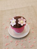 Sweet muffin with flowers Royalty Free Stock Photos