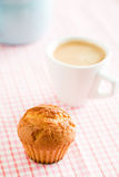 Sweet muffin on kitchen table Royalty Free Stock Image