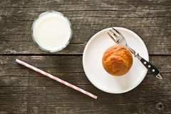Sweet muffin on old wooden table Royalty Free Stock Photography