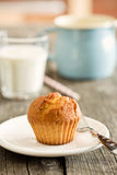 Sweet muffin on old wooden table Stock Images