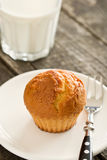 Sweet muffin on old wooden table Royalty Free Stock Image