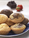 Sweet muffins. A variety of muffins in a plate stock photo
