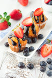 Sweet muffins with berries Stock Photos
