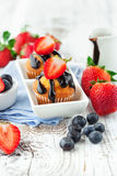 Sweet muffins with berries Stock Image