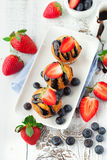 Sweet muffins with berries Stock Images