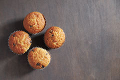 Sweet muffins. Muffins on a dark wooden table Royalty Free Stock Photo
