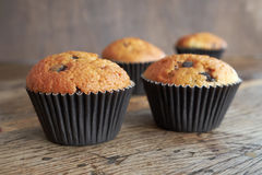 Sweet muffins. Muffins on a dark wooden table Royalty Free Stock Photography