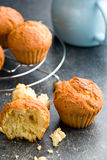 Sweet muffins on kitchen table Stock Image