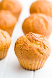 Sweet muffins on kitchen table Royalty Free Stock Photos