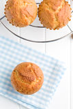 Sweet muffins on kitchen table Stock Photo