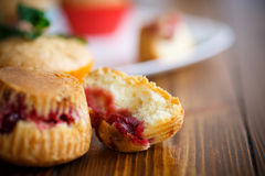 Sweet muffins stuffed with cherries royalty free stock photography