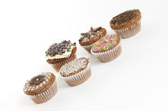 Sweet muffins on white background. Some sweet muffins on white background Royalty Free Stock Photos