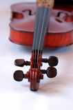 Sweet music. Image of a violin with narrow dof, focus is on the strings on the neck Royalty Free Stock Images