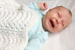 Sweet Newborn Baby Crying in Crib Stock Photography