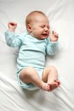 Sweet Newborn Baby Crying in Crib Stock Image