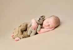 Sweet newborn baby embracing toy-hare Royalty Free Stock Photography