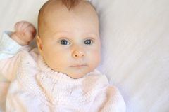 Sweet Newborn Baby Girl With Bright Blue Eyes Stock Photography