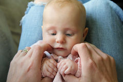 Sweet Newborn Baby Girl Holding Father's Hands Stock Image