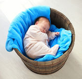 Sweet newborn baby sleep in bin Stock Image