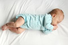Sweet Newborn Baby Sleeping on White Bed Royalty Free Stock Images