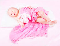 Sweet newborn baby with soft toy Stock Images