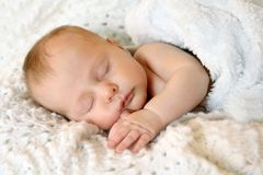 Sweet Newborn Infant Girl Sleeping in White Blankets Stock Image