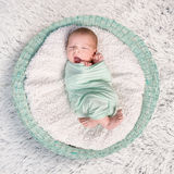 Sweet newborn wrapped in a nappy sleeping Stock Images