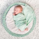 Sweet newborn wrapped in a nappy sleeping Stock Photos