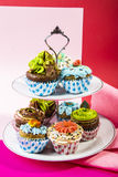 Sweet and nice cupcakes. Decorated cupcakes on a serving plate Royalty Free Stock Image