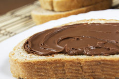 Sweet nutella. Hazelnut and chocolate spread over a slice of bread Stock Image