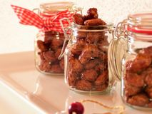 Sweet nuts in jars