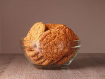 Sweet oatmeal. Cookies in glass plate Royalty Free Stock Photo
