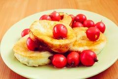 Sweet omelet with hawthorn, morning dessert. Om green plate Stock Photo