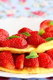 Sweet omelette stuffed with fresh strawberries on a white plate. Tasty and fluffy egg omelette idea. Breakfast recipe Stock Image
