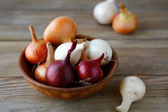 Sweet onions on wooden background Royalty Free Stock Photos