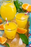 Sweet orange drink with ice and mint leaves royalty free stock images