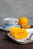 Sweet Orange jam roll cake with coffee Stock Photography