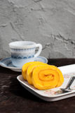 Sweet Orange jam roll cake with coffee Stock Image