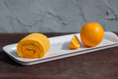 Sweet Orange jam roll cake Royalty Free Stock Image