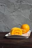 Sweet Orange jam roll cake Stock Photography