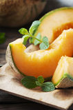 Sweet orange melon on the wooden table Royalty Free Stock Image