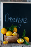 Sweet oranges and chalk board Royalty Free Stock Photo