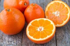 Sweet oranges fruits( mineola). On a white plate stock photo