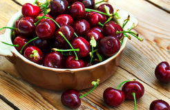 Sweet organic cherries in a bowl Royalty Free Stock Image