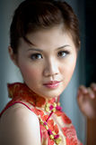 Sweet oriental girl. In a traditional Chinese dress Royalty Free Stock Photo