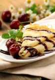 Sweet pancake with chocolate sauce Stock Photos