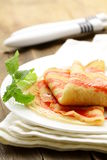 Sweet pancake with strawberry sauce Stock Photos