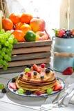 Sweet pancakes with fresh fruits Royalty Free Stock Image