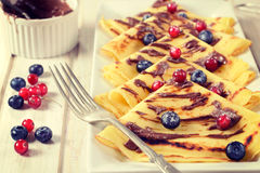 Sweet pancakes and fruit Stock Images